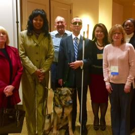 (Left to right) Patricia Leahy; The Honorable Janet LaBreck, Commissioner of the Rehabilitation Services Administration; Terry Smith; Dr. Frederic Schroeder, NRA Executive Director; Chelsea Nguyen; Lori Lawson; Minnie Christal.