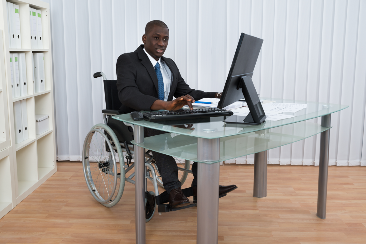 Wheel Chair At Laptop
