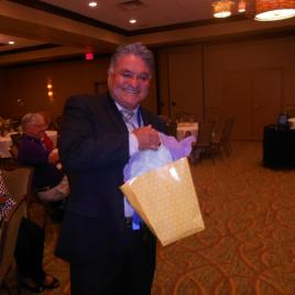 Raul Tello wins a Door Prize!