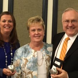 Greg Mason was presented with President's Award by NRA President Eleanor Williams (right) with Doris Illies, NRA President-Elect (left).